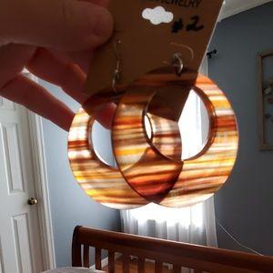 Acrylic circle dangle style earrings.
